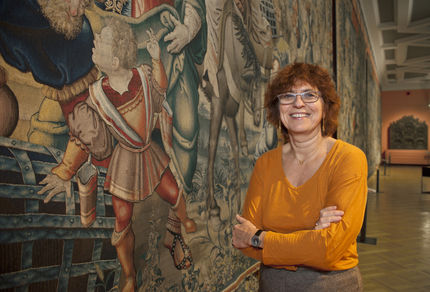 Ingrid De Meûter in the large gallery featuring tapestries from the Story of Jacob series